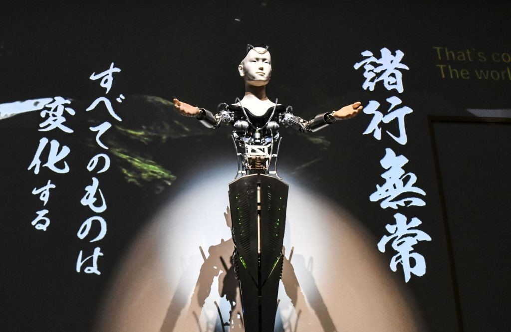 The Android Kannon Mindar gives a speech in tune with projected images and sound, in a dimly lit hall of Kyoto's Kodaiji temple, on Feb. 23, 2019. The robot, developed to explain the teachings of Buddha in plain terms, will begin preaching to the general public in early March. (Kyodo) ==Kyodo (Photo by Kyodo News via Getty Images)